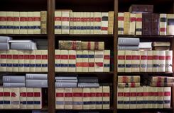 Bookshelf plenty of old legal books. Library law background Stock Photos