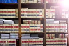 Bookshelf plenty of old legal books. Library law background royalty free stock images