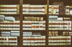 Bookshelf plenty of old legal books. Library law background Stock Images