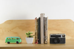 Bookshelf. With toy van, plant, old books and vintage camera stock photos