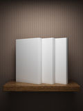 Bookshelf on the wall with books Royalty Free Stock Photo