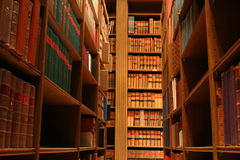 Bookshelves. In an old library stock photo