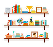 Bookshelves with books and cactus in pot Stock Photo