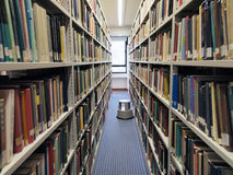 Bookshelves in library. Bookshelves with books in university library Stock Photography