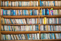 Bookshelves on street market in in second-hand book shop. Tuk-tuk, Sumatra, Indonesia - March 13, 2015: Bookshelves on street market in in second-hand book shop royalty free stock image