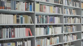 Bookshelves In Old Library With Lots Of Books Stock Footage