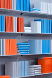 Bookshelves with the various books. White bookshelves with the various abstract books Royalty Free Stock Photo
