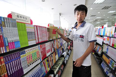 Bookshop,bookstore. Young man shops in a bookshop,new semester about to begin, the chinese students began to bookstores to buy books.Photo taken in August 28 Stock Photos