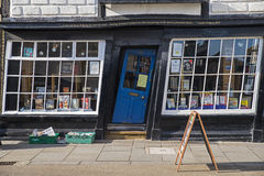 Bookshop with Slanted Door. CANTERBURY, UK - FEBRUARY 13TH 2017: A slanted door to a bookshop in the historic city of Canterbury in the UK, on 13th February 2017 Royalty Free Stock Photos