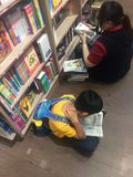 Bookstore. A boy reading books in bookstore HK international airport HK stock image