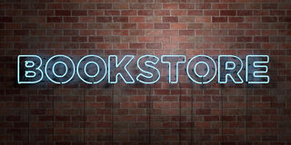 BOOKSTORE - fluorescent Neon tube Sign on brickwork - Front view - 3D rendered royalty free stock picture. Can be used for online banner ads and direct mailers Royalty Free Stock Photography