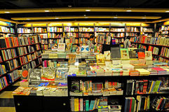 Bookstore interior. Active customers at a bookstore specialized in the distribution and sale of international publications. Location : page-1 bookstore at ocean stock image