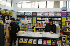 Bookstore at railway station. A passenger is selecting books at bookstore at railway station Tianjin China photoed on january 29th 2014 Stock Image