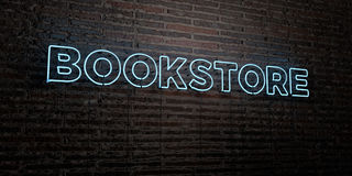 BOOKSTORE -Realistic Neon Sign on Brick Wall background - 3D rendered royalty free stock image. Can be used for online banner ads and direct mailers Stock Photos
