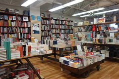 A Bookstore. Shelves and tables filled with books at a bookstore royalty free stock photos
