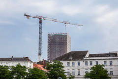 Bookstower in contention. Boekentoren in contention in Ghent next to a shipyard crane Stock Images
