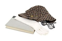 Bookworm. Shown by an old book with a houndstooth hat, thick glasses, and gloves - path included Royalty Free Stock Images