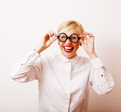 Bookworm, cute young blond woman in glasses, blond hair, teenage Royalty Free Stock Photo