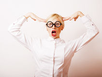 Bookworm, cute young blond woman in glasses, blond hair, teenage Royalty Free Stock Image
