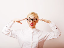 Bookworm, cute young blond woman in glasses, blond hair, teenage Stock Images