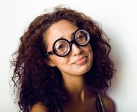 Bookworm, cute young woman in glasses, curly hair Royalty Free Stock Photo