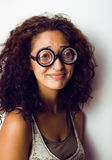 Bookworm, cute young woman in glasses, curly hair, teenage Royalty Free Stock Images