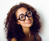 Bookworm, cute young woman in glasses, curly hair, teenage Stock Images