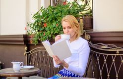 Bookworm leisure concept. Mug of good coffee and pleasant book best combination for perfect weekend. Girl drink coffee. Every morning at same place daily ritual stock images