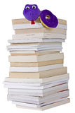 Bookworm on a pile of books isolated. On a white background Stock Photos