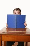 Bookworm reading book. A child sitting down reading a book Royalty Free Stock Photography