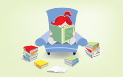 Bookworm. Shes reading a book on the blue armchair Stock Photography