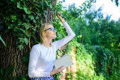 Bookworm student relaxing with book green nature background. Spend leisure with avail. Girl keen on book keep reading. Woman blonde take break relaxing in park royalty free stock photography