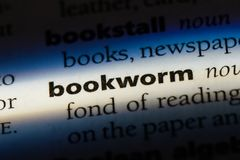 Bookworm. Word in a dictionary.  concept royalty free stock photos