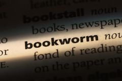 Bookworm. Word in a dictionary.  concept royalty free stock images
