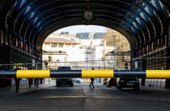 Boom Barrier. Closeup of black and yellow boom barrier with background of Smithfield market in London royalty free stock photography