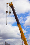 The boom of construction crane with the hook. Cloudy sky backgro Stock Photo