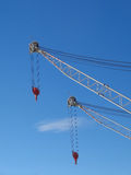Boom crane against blue sky. The boom of the crane in sea port Stock Image