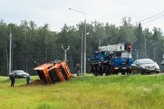 A boom crane arrived for lifting an overturned lorry, Moscow suburbs, Russia. Stock Photos