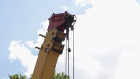 The Boom of a Crane. Boom of building construction crane in forest stock video