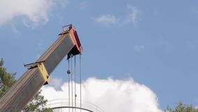 The boom of the crane. Boom of building construction crane in forest stock video footage