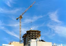 The boom of a crane, lifting the load royalty free stock photography