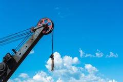 Boom crane on the sky background. Stock Photos