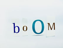 Boom - Cutout Words Collage Of Mixed Magazine Letters with White Background. Caption composed with letters torn from magazines with White Background Royalty Free Stock Image