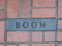 Boom! Engraved in to Brick Stock Photography