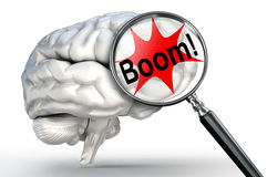 Boom explosion word on magnifying glass and human brain Stock Photo