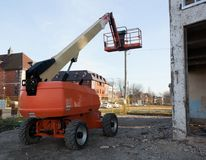 Boom Lift Construction Site. Boom Lift parked on Construction Site with boom raised Stock Photography