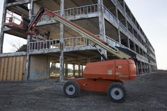 Boom Lift Construction Site. Boom Lift parked on Construction Site with boom raised Royalty Free Stock Images