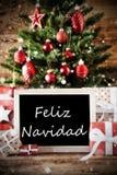 Boom met Feliz Navidad Means Merry Christmas Stock Afbeeldingen