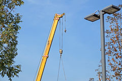 Boom of mobile crane with blue sky background. Stock Images