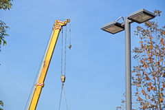 Boom of mobile crane with blue sky background. Royalty Free Stock Photo